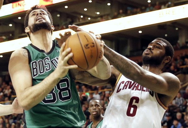 Boston Celtics center Vitor Faverani (38) battles with Cleveland Cavaliers small forward Earl Clark (6) for the ball during the first quarter at TD Garden on Friday night.