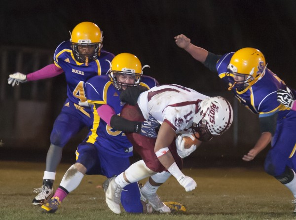 Orono running back Christian Mowrer (11) gets tackled by Bucksport defensive back Asher Bowden (31) in the first half in Bucksport, Maine, Friday, Nov. 8, 2013.