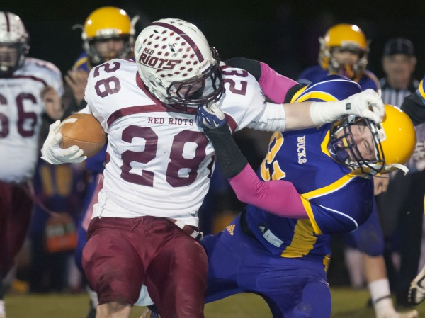 Orono running back Collin Clement (28) gets some some tough yards against Bucksport defensive back Asher Bowden (31) in the first half in Bucksport Friday, Nov. 8, 2013.