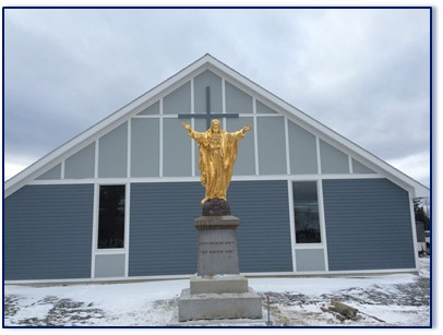 The statue of Jesus damaged by vandals in June 2010 was placed Tuesday in front of the recently completed St. Faustina Catholic Church.