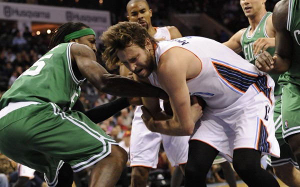 Charlotte Bobcats forward Josh McRoberts (11) and Boston Celtics forward Gerald Wallace (45) fight for the ball during the second half of the game at Time Warner Cable Arena in Charlotte, N.C., Monday night.