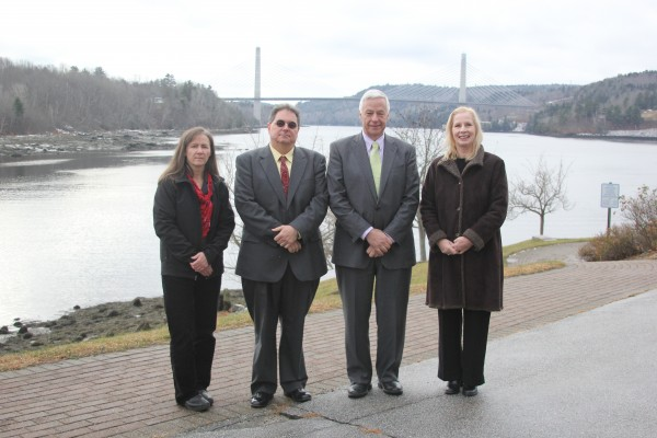 Standing in front of the Penobscot Narrows Bridge for the announcement of the $10.5 million grant and loan package, include Laura Rose Day of the Penobscot River Trust, left, Bucksport Town Mananger Michael Brennan, U.S. Rep. Mike Michaud, and USDA state rural development director Virginia Manuel, right,