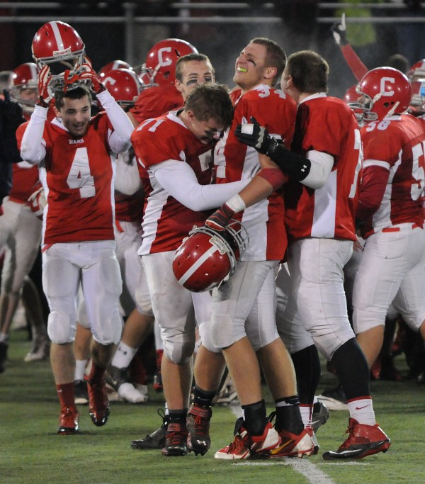 With 15 seconds still on the clock and possession of the ball, Cony football players start to celebrate their win over Kennebunk 30-23 at the Class B state football championship game on Friday at Orono.