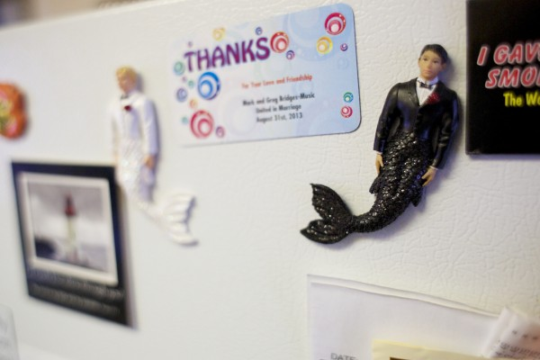 Mermen magnets stick to a refrigerator at the home of Bangor residents Greg Bridges-Music and his husband Mark. Both men are active in the LBGTQ community and in the christian community.