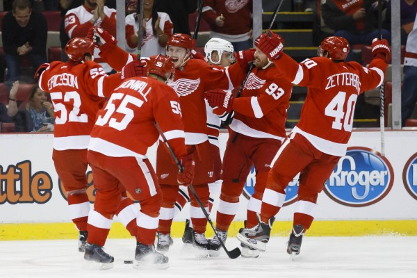 Detroit Red Wings center Gustav Nyquist (center) receives congratulations from teammates after scoring a goal in the first period against the Carolina Hurricanes at Joe Louis Arena in Detroit Thursday night.