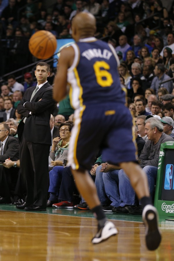 Boston Celtics head coach Brad Stevens watches from the sideline as Utah Jazz guard Jamaal Tinsley (6) controls the basketball in the first quarter at TD Garden in Boston Wednesday night.