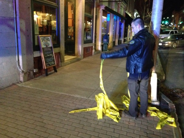 Bangor police mark off an area in Pickering Square on Wednesday night after a report of a bomb downtown.