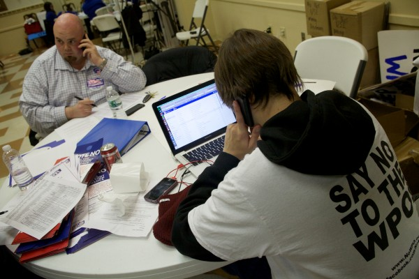 Tim LaBerge (left) and Cameron Jackson make a few more calls to voters in South Portland Tuesday night to try and defeat the proposed waterfront protection ordinance.