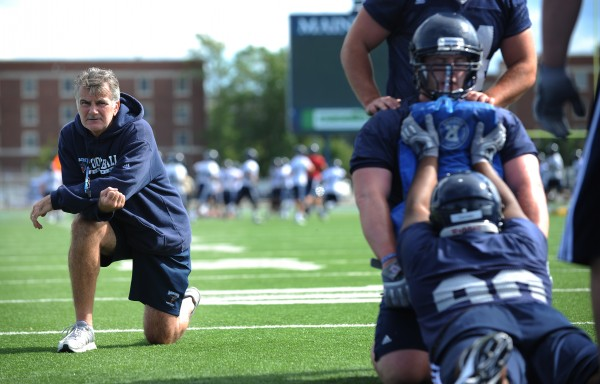 UMaine head coach Jack Cosgrove watches as the UMaine defense drills on Morse Field during the first practice of the football season in August.