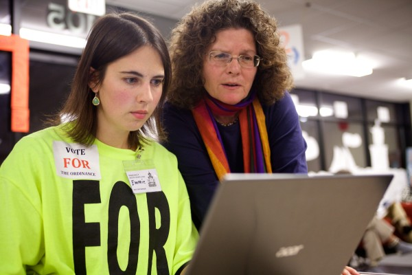 SOUTH PORTLAND, MAINE -- 11/05/13 -- Emmie Theberge of Protect South Portland (left) and Judy Berk of the Natural Resources Council of Maine look at their laptop as the election unfolded Tuesday night in South Portland. Troy R. Bennett | BDN