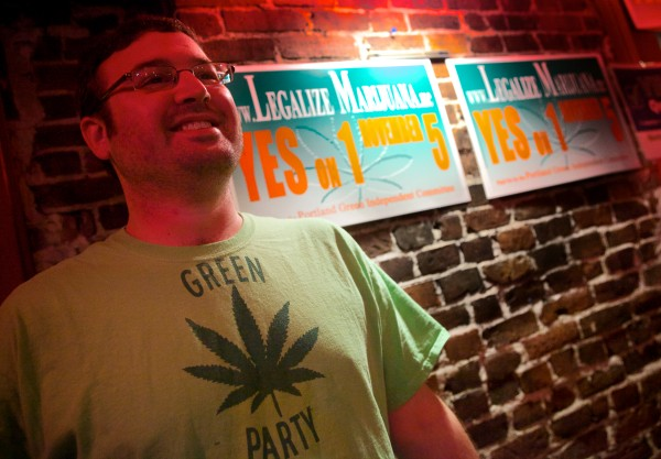 Campaign manager Tony Zeli smiles at the &quotYes On 1&quot headquarters in Portland Tuesday night. Question One would legalize recreational use of marijuana.