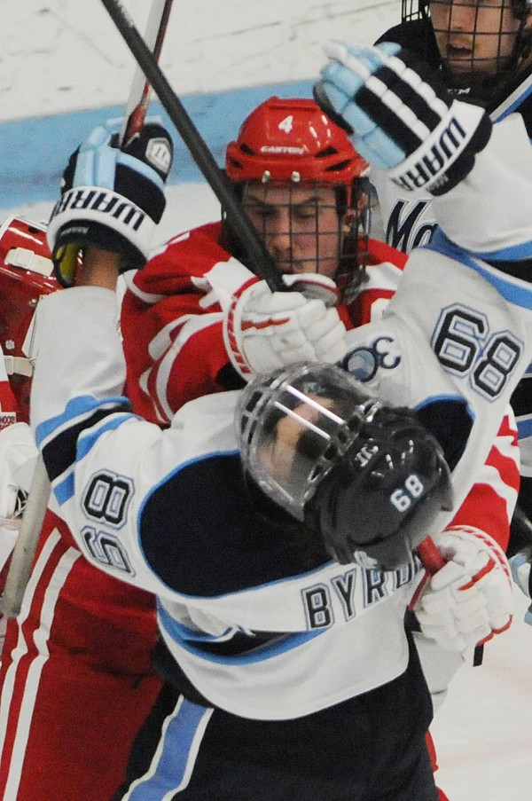 UMaine's Blaine Byron gets chopped in the face with a stick by Boston University's Patrick MacGregor during first period action on Friday at Orono.