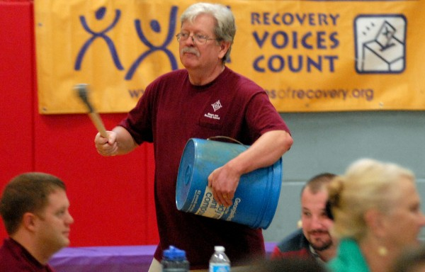 Bruce Campbell, clinical director of Wellspring, beats on a bucket during a drumming circle to introduce the Bangor Area Recovery Network's fifth annual summit on addiction recovery last year.