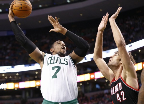 Boston Celtics power forward Jared Sullinger (7) shoots the ball against Portland Trail Blazers center Robin Lopez (42) during the second half at TD Garden in Boston Friday night.