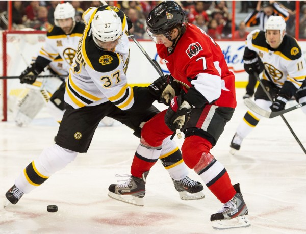 Boston Bruins center Patrice Bergeron (37) and Ottawa Senators center Kyle Turris (7) face off in the second period at the Canadian Tire Centre in Ottawa Friday night.