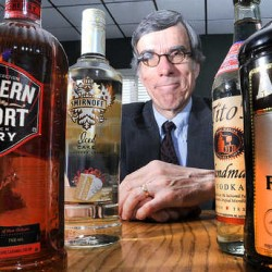 Two companies slam competing liquor contract bill