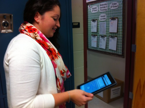 Kristy Eaton, an Ellsworth High School senior, checks an app to find out where she's supposed to be during study hall.