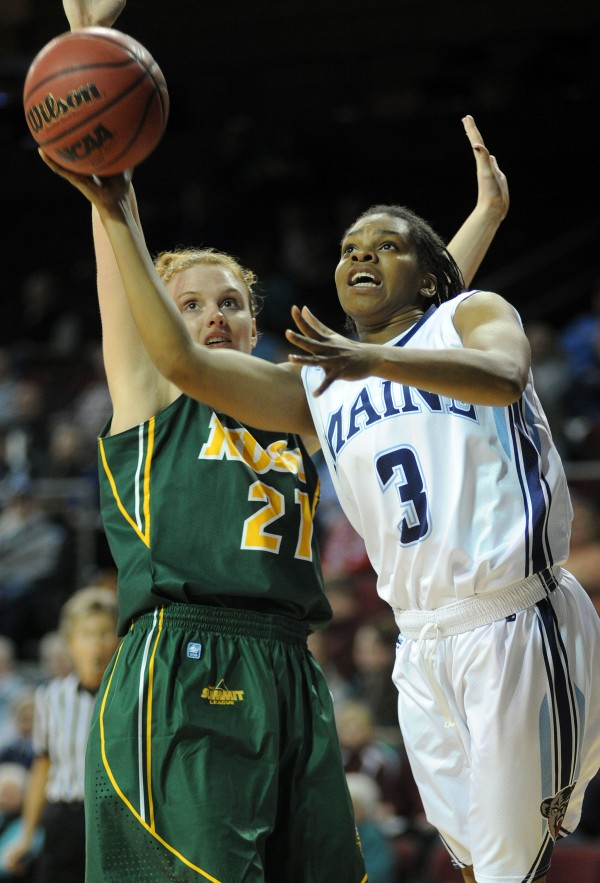 UMaine's Chantel Charles shoots with pressure from North Dakota State's Liz Keena during first half action on Thursday at Bangor's Cross Insurance Center.