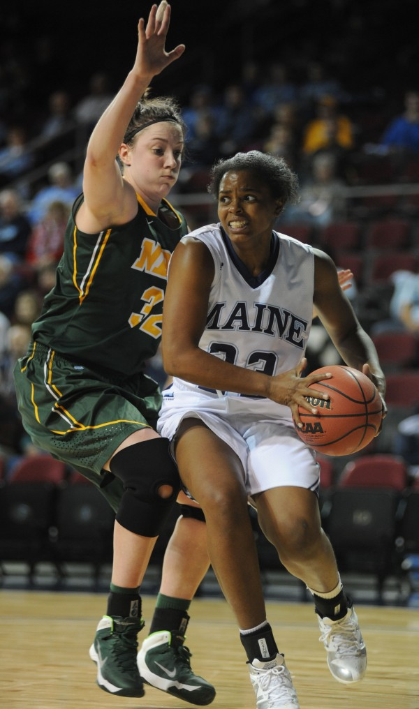 UMaine's Ashleigh Roberts looks to pass or shoot while under the basket being guarded by North Dakota State's Marena Whittle during first half action on Thursday at Bangor's Cross Insurance Center.