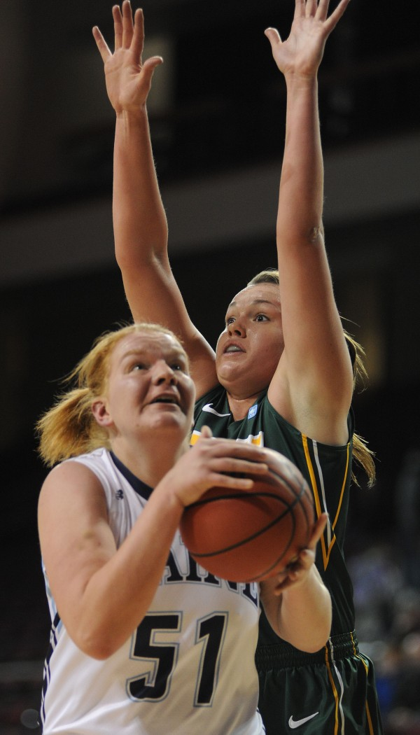 UMaine's Anna Heise shoots with pressure from North Dakota State's Emily Spier during first half action on Thursday at Bangor's Cross Insurance Center.