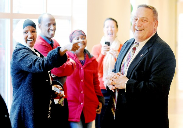 Gov. Paul LePage shares a laugh with Fatuma Hussein at the B Street Community Center in Lewiston on Monday. LePage met with local immigrants to hear about the challenges they face in trying to find employment.