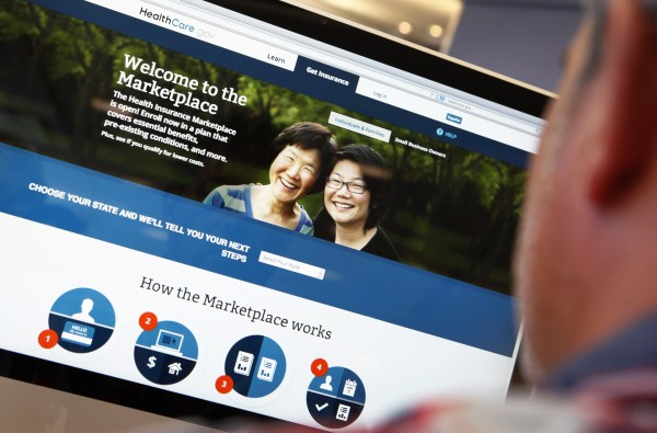A man looks over the Affordable Care Act sign-up page on the healthcare.gov website in New York last month.