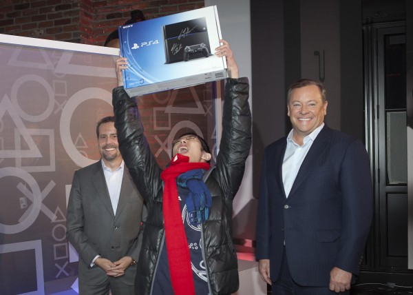 Joey Chiu, 24,  holds up his Sony Playstation 4 console, next to Jack Tretton, right, President and CEO of Sony Computer Entertainment of America, at a special sale event put on by Sony at the Standard Hotel in New York on Nov.14, 2013.