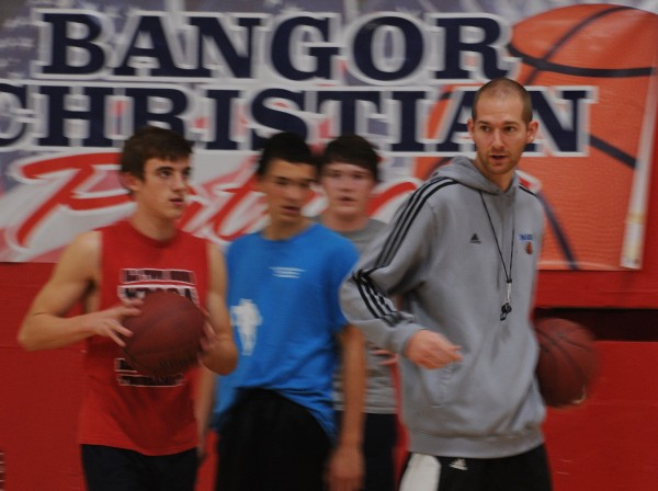 Basketball coach Jon McAllian leads his new team at Bangor Christian in drills on Monday.