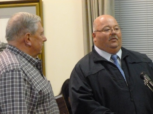 Retired Brewer police Sgt. Arden Jones (left), who retired from Brewer Police Department at the end of September, was honored for his years of service to the city by Chief Perry Antone at the Nov. 18, 2013, Brewer City Council meeting.