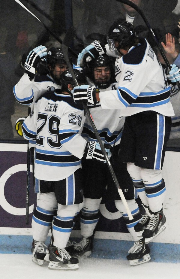 UMaine hockey players celebrate their first goal against  Boston University during first-period action Nov.15, 2013, at Orono.
