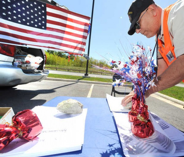 Roger Goodoak arranges material on a makeshift table outside his van in the parking lot of the VA Clinic in Lewiston in this file photo. He works for a group created by homeless veterans called Southern Maine Veterans Alliance whose goal is to help homeless veterans with life's necessities, such as driving them to agencies, homes and other charitable organizations, and buying them shoes, pots and pans, gloves and coats.