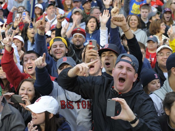 Boston Red Sox fans cheer during the World Series parade and celebration on Boylston Street.