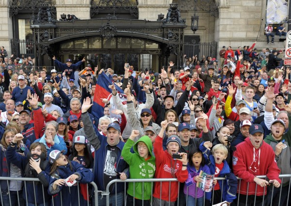 Boston Red Sox fans cheer in Copley Square during the World Series parade and celebration.