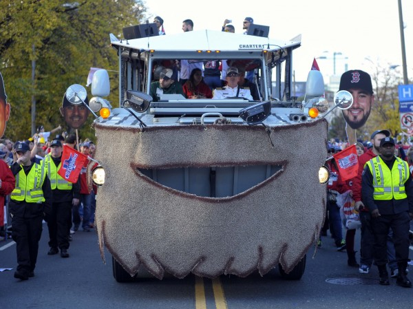 A duck boat with a beard carrying Boston Red Sox players travels along Boylston Street during the World Series parade and celebration.