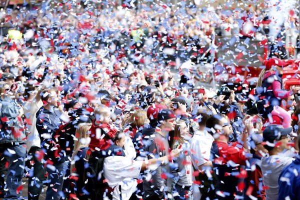 Boston Red Sox fans are showered with confetti during the World Series parade and celebration.