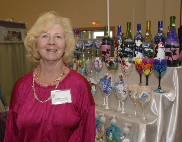 Weekly Photo by Brian Swartz During the United Maine Craftsmen show held at the Cross Insurance Center, Althea Boyle of Belgrade displays her exquisitely painted glassware, including wine glasses, soap dispensers, salt and pepper shakers, and bottles with lights, that she creates for her business, Mainely Pets. Boyle is the UMC president.