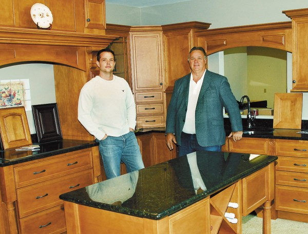 John Cousins (right) and his son J.C. in the Atlantic Designs showroom.