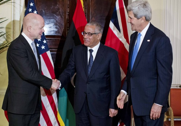 U.S. Secretary of State John Kerry (right) watches as British Foreign Secretary William Hague (left) shakes hands with Libyan Prime Minister Ali Zeidan at Winfield House, the residence of the U.S. Ambassador to Britain, in London, Nov. 24, 2013.