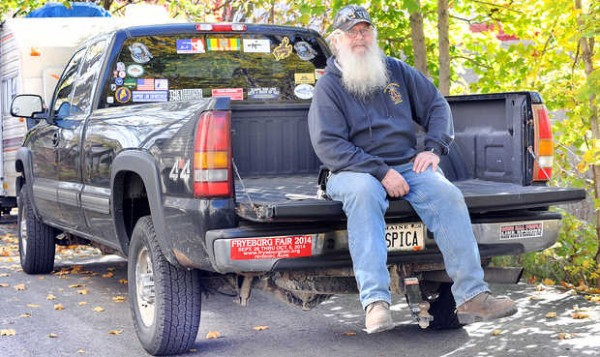 Mickey Meader sits on the tailgate of his 2002 Chevy 4x4 Duramax truck that has 314, 268 miles on it.