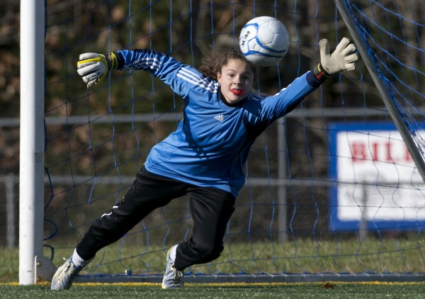 Bangor goalie Emily Gilmore reaches in vain as Windham scores their third goal in the second half of the Class A girls soccer state championship, Saturday, Nov. 9, 2013, in Bath, Maine.