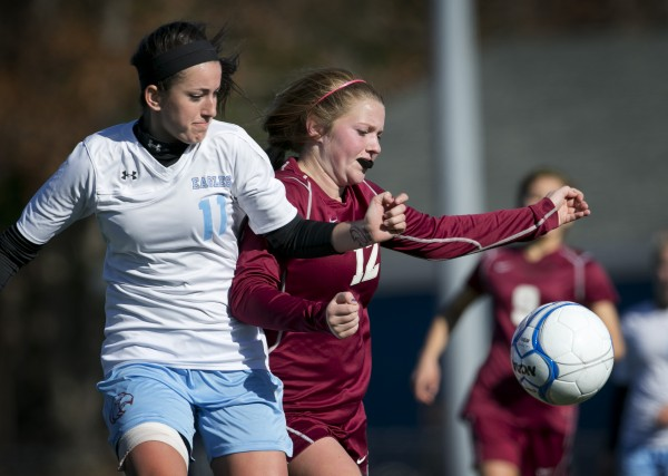 Windham's Ariana Davidson (left) and Bangor's Megan Connor battle for ball in the first half of the Class A girls soccer state championship, Saturday, Nov. 9, 2013, in Bath, Maine.