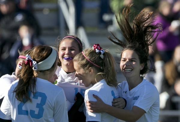 Windham's Lauren Shoemaker (right) joins her teammates to celebrate the Eagle's first goal during the second half of the Class A girls soccer state championship, Saturday, Nov. 9, 2013, in Bath, Maine.