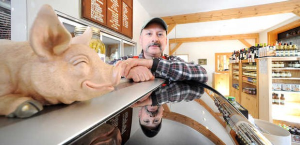 Andre Bonneau, president of Maurice Bonneau's Sausage Kitchen on Main Street in Lisbon Falls, says he's sick of businesses leaving town.