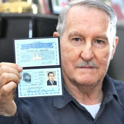 Edward Maynard displays his Washington, D.C. Police Department ID during a recent interview at his home in Lewiston. Maynard was a patrol officer in the 1960s, assigned to an honor squadron that protected VIPs in the nation's capital.
