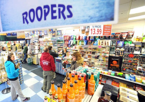 Customers line up at Roopers on Sabattus Street in Lewiston on Friday night. The agency liquor store made nearly $1.6 million in sales last year, the fourth-highest in the state.