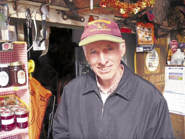 John Calkins, co-owner of Calkins Farm Stand in Hampden, is the third generation to operate the business on Route 1A.