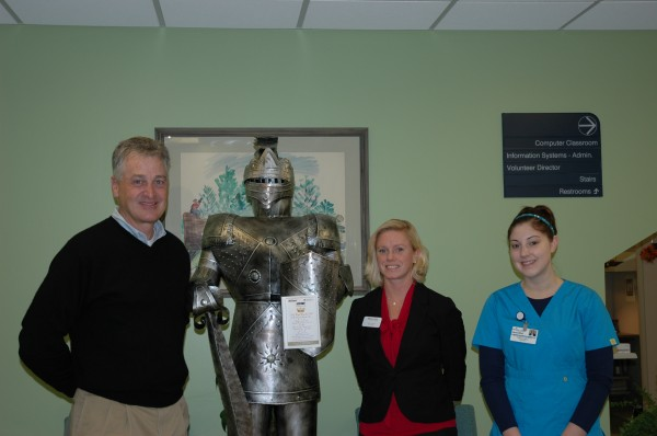 Ultrasonographer Jennifer Russotti, BS, RDMS  with Bob Foster, President  of R. H. Foster, and Sarah Cantanese, Branch Manager of Machias Savings Bank.  The 22nd Annual Poinsettia Ball will benefit a new ultrasound unit at Maine Coast Memorial Hospital.