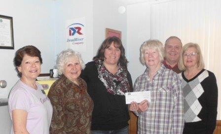 The Calais Schoodic Sculpture Committee was pleased to accept a $1000 donation from the Dead River Company.   Left to right are Marianne Moore, Suzanne Crawford, Lisa Newsom, Market Manager of Calais Dead River, Heather Ross, Jim Porter and Katherine Berry.