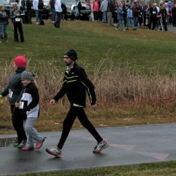 Jay schools' running, race-walking and skiing coach and educator Randy Easter, left center, strides past fellow participants at the Spruce Mountain High School track in Saturday afternoon's Running for Randy 1-mile family fun run/walk fundraiser for Easter in his fight against cancer.
