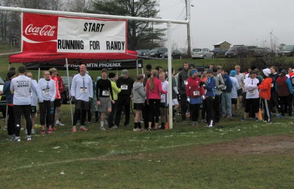 Participants in Saturday afternoon's 5k Running for Randy fundraiser for Randy Easter await the start of the cross-country run starting and finishing at the Spruce Mountain High School football field in Jay. More than 570 people of all ages participated in the run and a 1-mile family fun run/walk event.